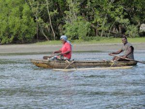 locals on dugout vanuatu
